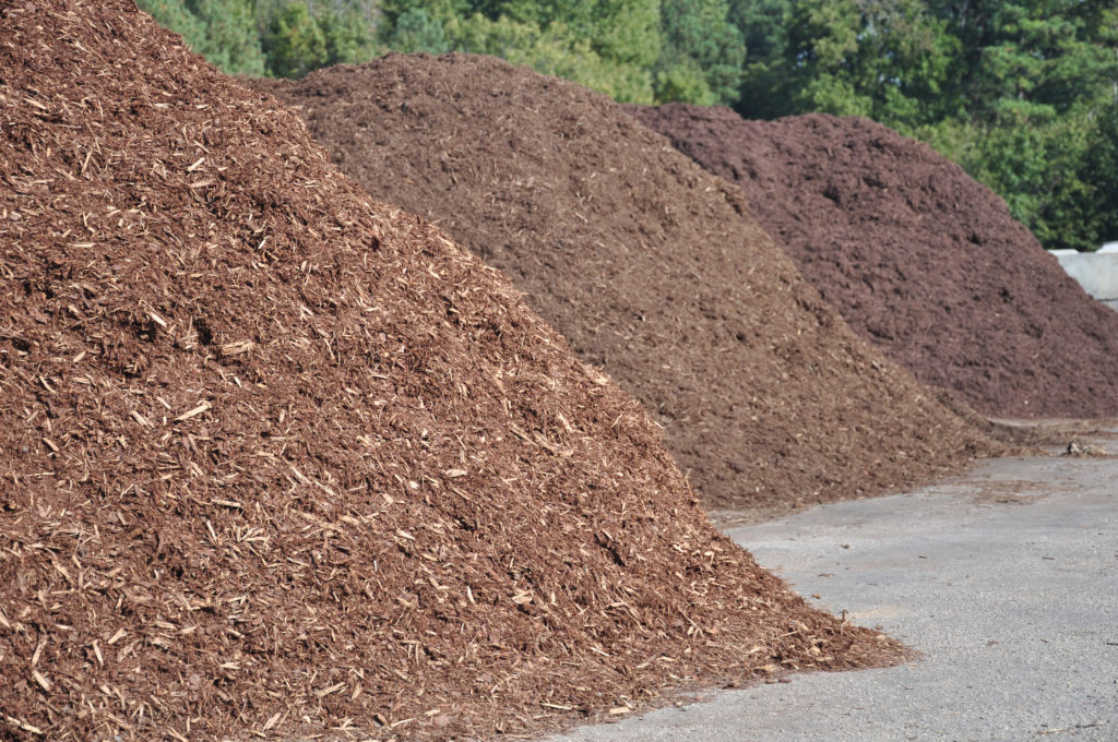 Three different types of mulch for sale at garden center